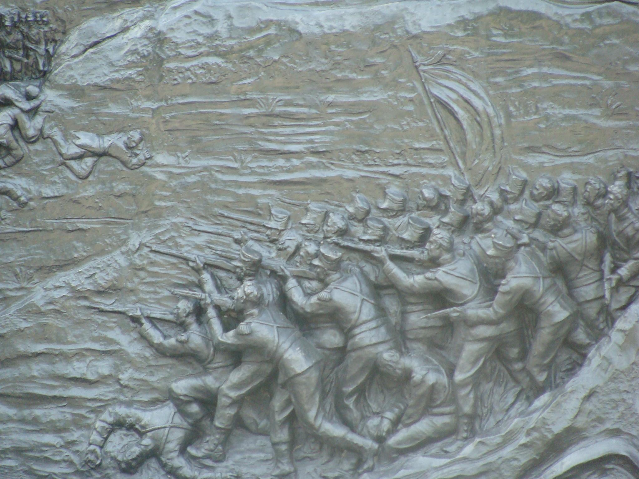 grabados de la batalla en el monomento de el altar de lapatria